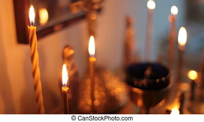 Burning candles - burning candles in a church