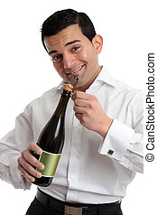 Man or bartender opening wine champagne - A cheerful...