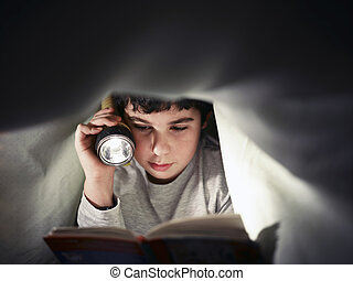 boy reading book - caucasian child reading book under the...