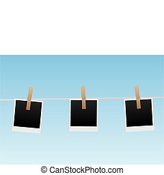 Polaroids - Image of pictures hanging on a clothesline with...