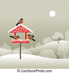 Birdfeeder in winter forest - Winter forest landscape with...