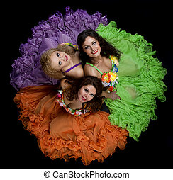 Three woman in color carnival costume - top shot