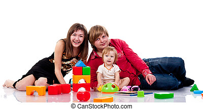 Family playing with toys isolated