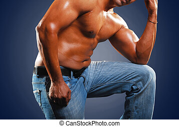 grappler in jeans isolated on a blue background