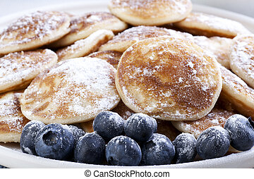 Pancakes and Blueberries - Dutch mini pancakes, or...