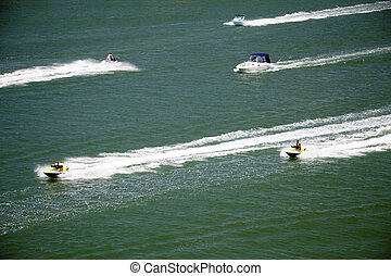 Busy Waters - Seadoos and jetskies speeding on the water