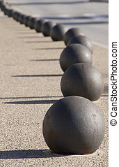 street ball - a metal ball separating the pedestrian from...