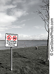 no camping or overnight parking sign