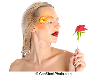 Young woman bites red flower