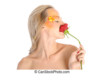 Young woman bites flower