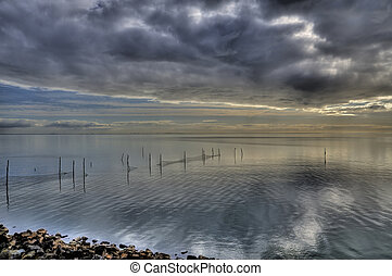 ijssel lake hdr - ijssel lake in the netherlands with cloudy...
