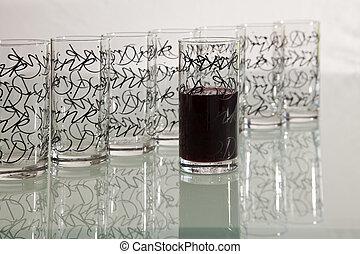 Half Full - Half full glass among the empty glasses