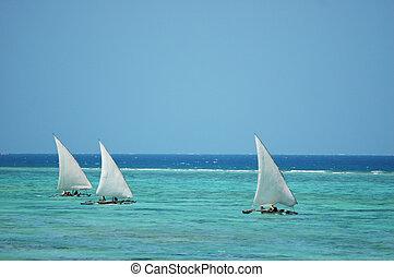 Fishing boats sailing on sea