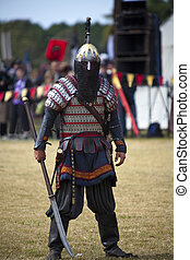 Ready To Fight - Knight dressed in armour with weapon