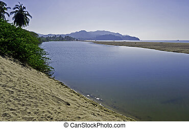 Tranquil estuary by the Pacific Ocean - Estuary by the...