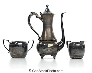 Antique Tea Set - Antique metal tea pot, a milk jug and a...