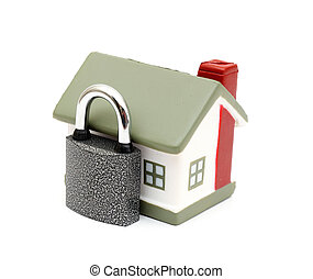Home Security - miniature house with lock and chain isolated...