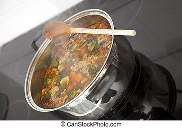 Simmer - Stew cooking in a stainless steel pot