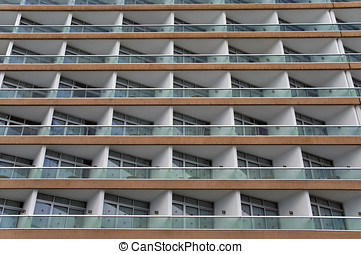 Glass balconies with identical appearance Repetitive...