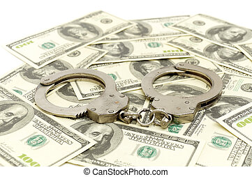 Handcuffs on money background, business security concept