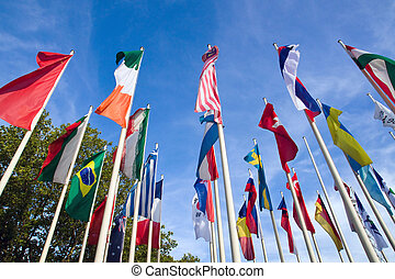 International Flags with trees and blue skies in the...