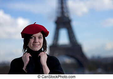 girl wearing a red beret and the eiffel tower