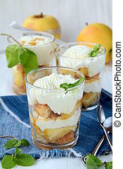 dessert apples and whipped cream in a glass beaker