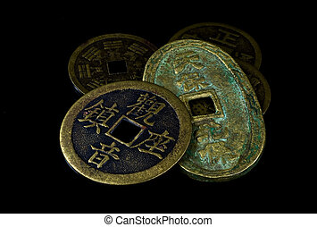 Chinese coins on black - Old Chinese coins isolated on black...