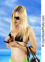 Sexual girl on beach with moble phone - Sexual girl on beach...