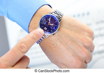 Business time - Businessman looking at the watch