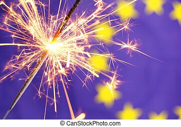 eu flag and sparkler - eu or european union flag with...