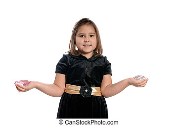 5 Year Old Girl - A 5 year old girl holding fake diamonds in...