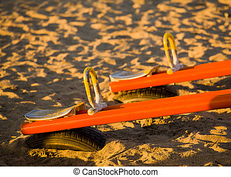 Children's playset on beach - See-saw on sandy beach in...