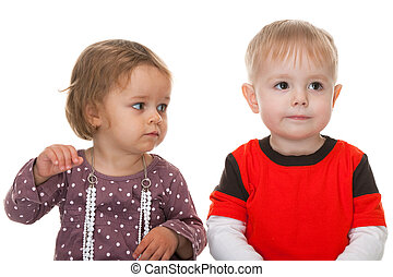 Two friendly toddlers - A portrait of little cute girl and...
