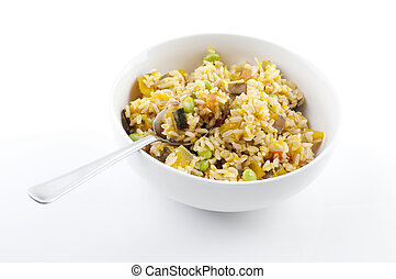 Pumpkin fried rice - Bowl of pumpkin fried rice on white...