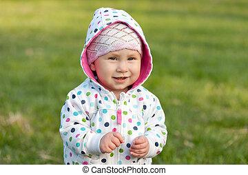 Smiling little girl outdoors