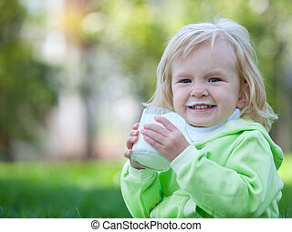 Happy toddler with milk moustache - A laughing little girl...