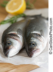 Fresh sea bass - Two fresh sea bass with lemon and rosemary