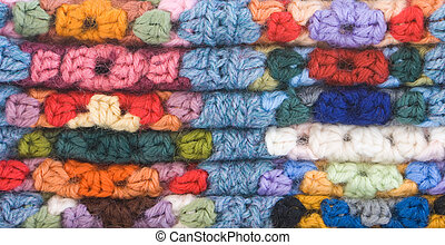 Knitted Crochet Squares - Close up macro shot of knitted...
