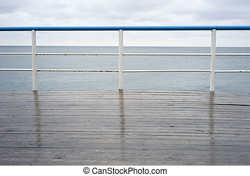Handrail on a deck in the rainy day