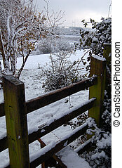 snowy stile - winter scene of stile on walk