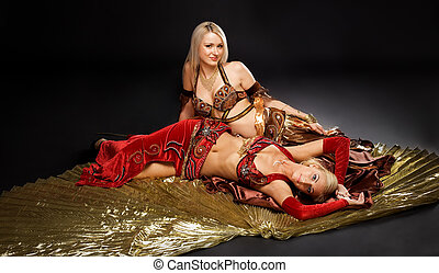 Two young woman lay on gold wing