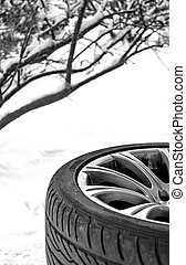 Winter Snow Tire - Changing Snow winter tire on white...
