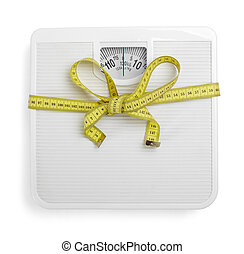 scale libra measurement tape diet - close up of scale and...