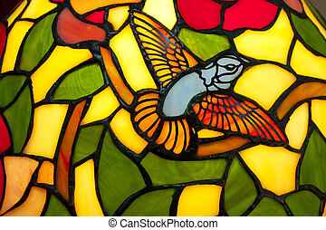 Stained Glass - A bird in stained glass of  lamp.