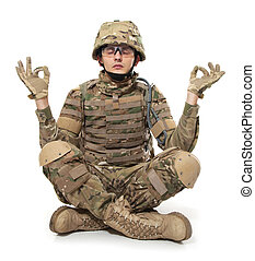 Modern soldier meditating. Isolated on a white background