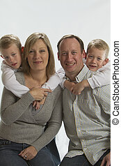 Happy parents with 6 years old identical twins