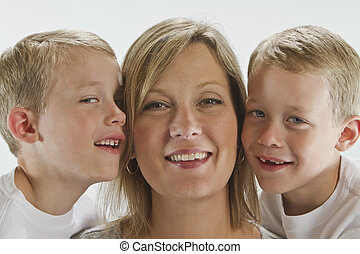 Happy Mom with 6 years old identical twins