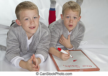6 years old identical twins writing letter to Santa