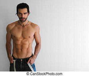 Fitness model - Body portrait of a sexy young man in jeans...